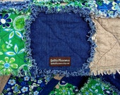 Large rag quilt in vibrant blues and greens