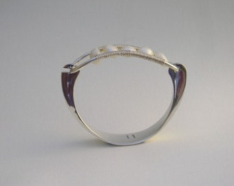 Forged sterling silver bracelet with Baroque pearls.