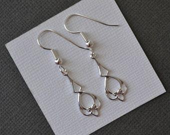 Hearts with Diamond Drops . Earrings