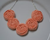Coral fabric rolled rosette necklace
