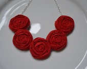 Red fabric rolled rosette necklace