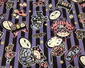 Alice in wonderland fabric black and purple one yard