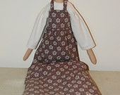 Tall skinny folk style doll with Calico dress, and brown Shweshwe pantaloons, apron and hat