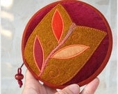 Tulip Window circular unique ornamented zipper wallet cherry red,  terracotta and mustard colors