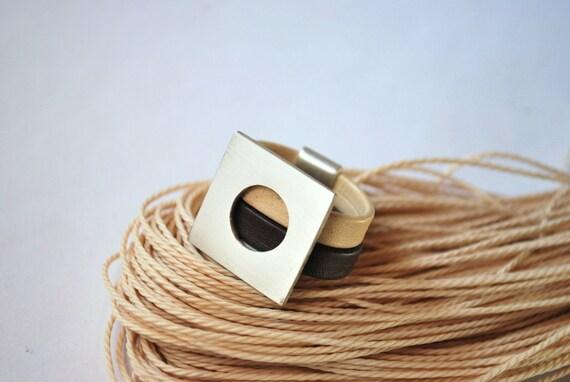 Geometric ring / bicolor leather