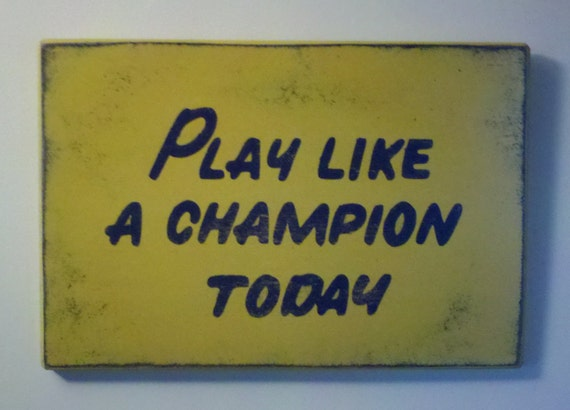 """Play Like A Champion Today Wood Sign 12"""" x 18"""""""