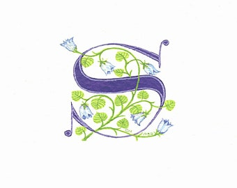 Initial letter 'S' handpainted in dark blue with bluebells on watercolor paper.