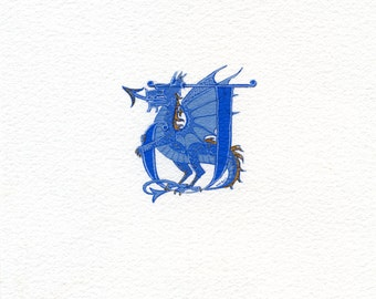 Initial letter 'J' with blue and gold dragon.
