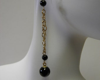 Women black dressy long gold filled earrings with onyx beads.