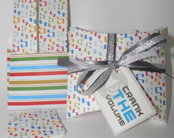 Money holder card and pillow box gift wrap combo with music notes.