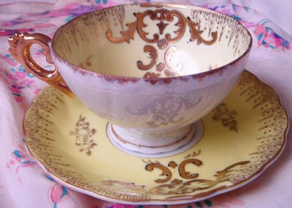 Porcelain Rococo Gold Trim Buttercup Teacup