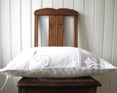 cushion in an antique French cloth with monogram and hand-made lace, white