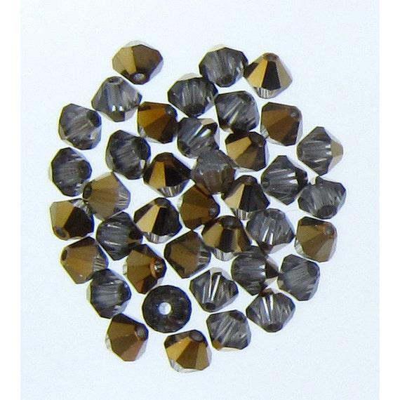 CLEARANCE :  Swarovski 5301 4mm Dorado Xilion Bicone Beads Whole sale price Bulk Quantity 1 Gross (2638)