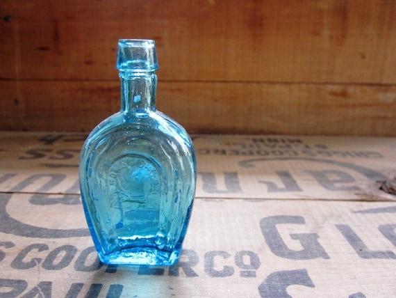 Vintage Mini Bottle In Blue with Horseshoe Design