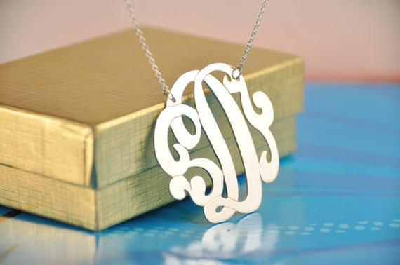 "silver  initial with swirls 1.50"" size. chain included"