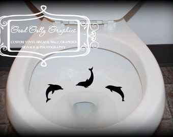 Taking Aim toilet targets: THREE piece collection of DOLPHINS
