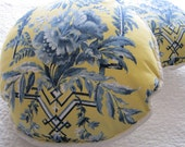 Two matching blue and yellow floral pillows with water taffeta backing