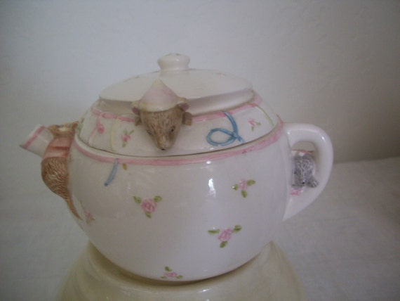 Teapot with mice peeking out