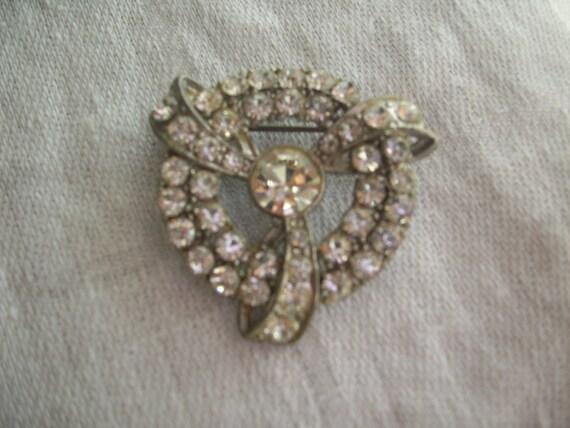 Antique circular rhinestone brooch