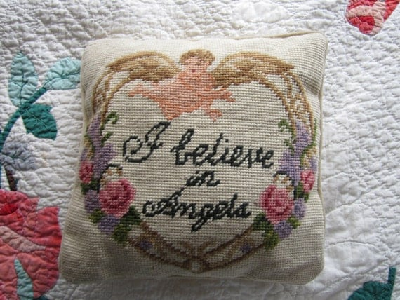 "Needlepoint pillow with ""I believe in Angels"""