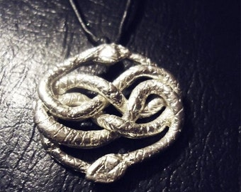 silver necklace charm inspired by Auryn from the Neverending Story