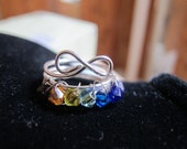 Silver wire wrapped infinity ring with rainbow Swarovski crystals, can be made in any size