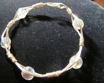 Silver wire bangle bracelet with round, clear crystals