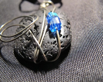 Lava stone silver wire wrapped pendant with blue crystals
