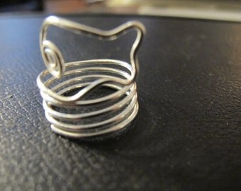 Silver wire wrapped swimming fish ring