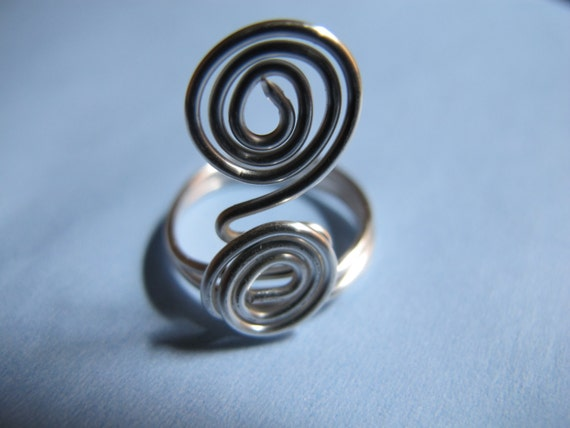 Silver wire wrapped coil ring with spirals