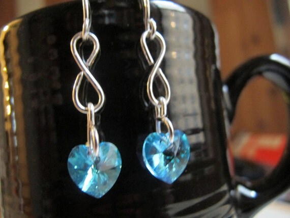 Silver infinity earrings with turquoise Swarovski hearts