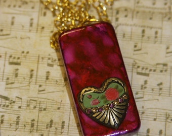 Domino ink stained pink, red, gold heart with flowers necklace