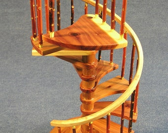1/12 scale, 8 inch red cedar rustic spiral staircase with curved landing tread.