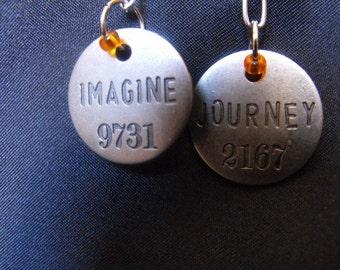 Imagine and journey earrings