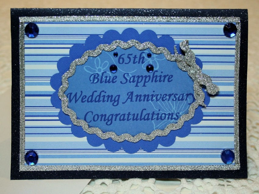 Th blue sapphire wedding anniversary by amylouiselace on