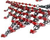Vintage bib necklace made with web of red faceted glass beads Code U82