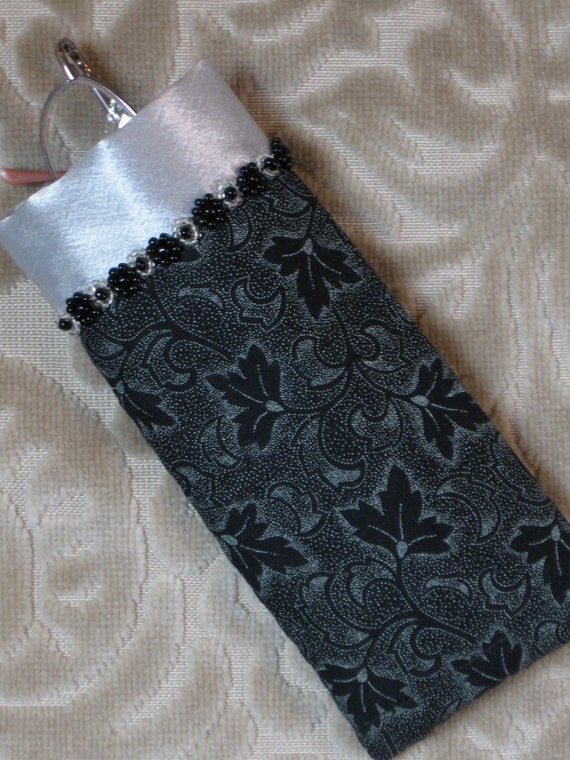Black and white eyeglass case with silver satin trim and beads