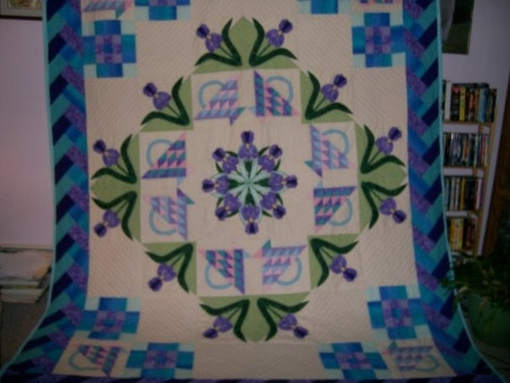 Queen size quilt with an iris medallion
