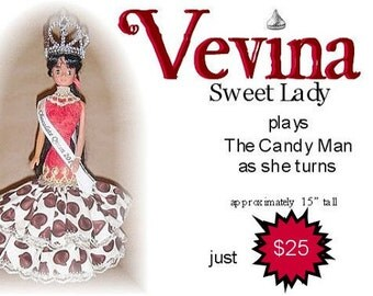 Vevina, ooak musical doll. Plays The Candy Man as she turns.