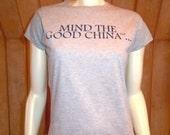 Peach Carr Project Runway ladies' size MEDIUM T-Shirt