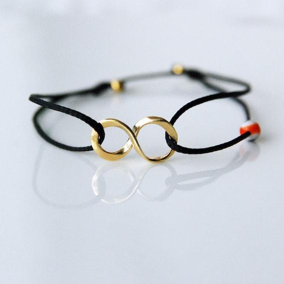 Gold infinity bracelet on black cord, Evil eye bracelet, girlfriend gift