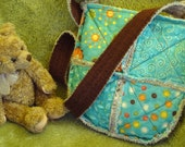Seams to be Hip Bag in Blue Prints with Brown Trim