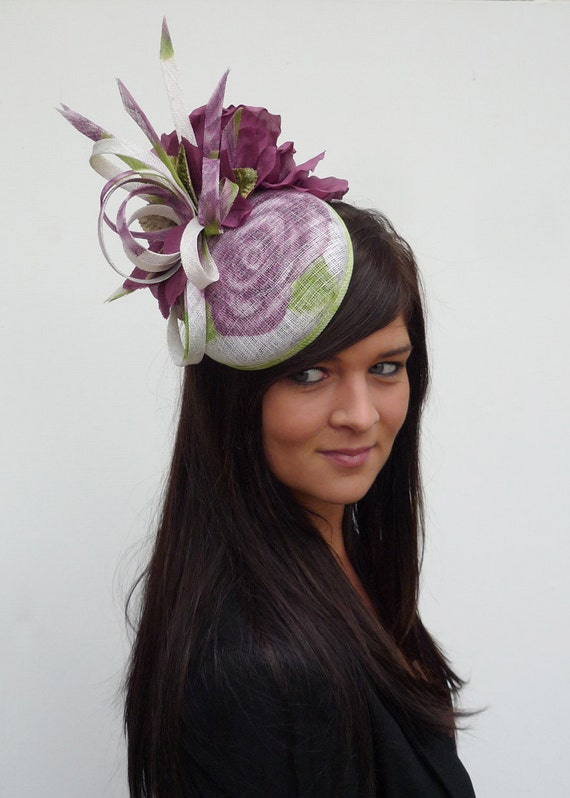 Couture multiple colour flower headpiece made of sinamay, silk and velvet on aliceband.