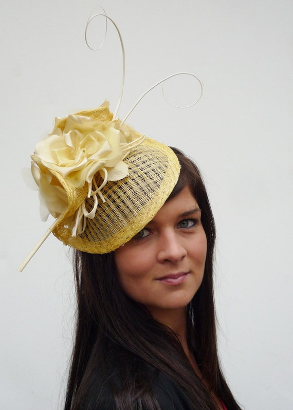 Dutch design couture yellow hat open sinamay with roses, buts and feathers on aliceband