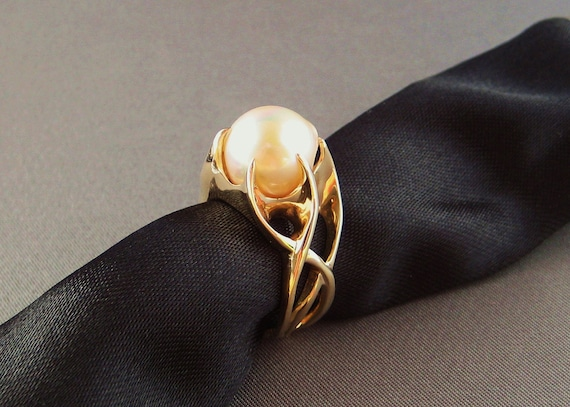 """Liquid fire ring in 14kt yellow gold titled """"Aquos"""" with golden baroque pearl"""