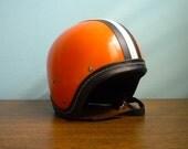 Vintage motorcycle orange helmet black white stripes