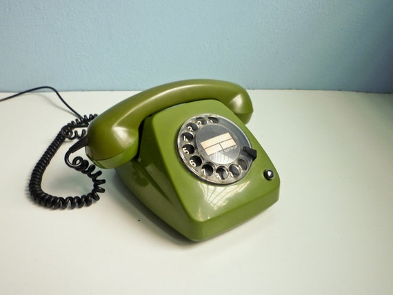 Vintage dial rotary green telephone 70s