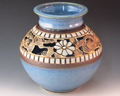 Vase With Flowers, Swirl Design, And Soft Blue Border Of Squares
