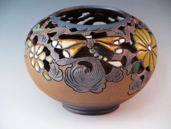 Round Vase Wtih Cutouts, Flowers, And Dragonflies With Swirl Design