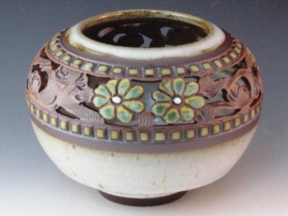 Vase With Cutouts, Flowers, And Swirl Design